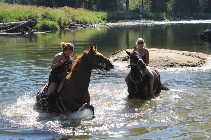 Crossing the river on horseback